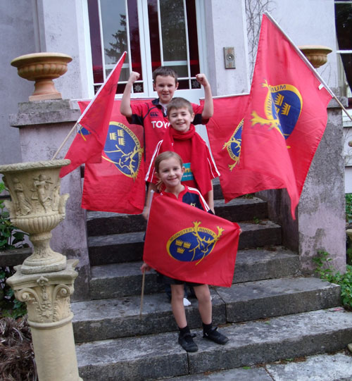 Evan, Niall and Orna from Co. Cork show their support for Munster