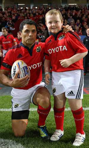 Junior Club member Danny McCarthy as the match day mascot with Munster Captain Doug Howlett before the Newport Gwent Dragons game in Thomond Park