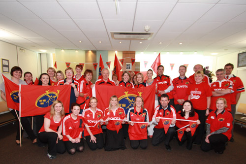 Staff from Ronan Daly Jermyn Solicitors in Cork City decked out in red