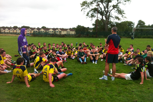 John Lacey speaks to both the North and South Munster players after their game