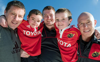 James Coughlan, Donnacha Ryan and Peter Stringer give the Kelly brothers a helping hand