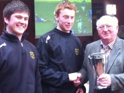 John Noonan, Munster Branch, presents the U21 SW league trophy to U21 vice-captains Brian Danagher and Evan Mulcahy