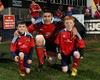 Captain Billy Holland with Munster mascots Michael Carroll and Conor Casey