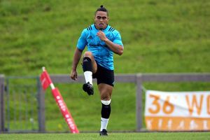New signing Francis Saili warms-up before taking to the field.