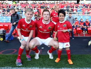 Captain on the night, Cathal Sheridan, with mascots Alan Fitzgerald (10) and Sam O'Callaghan (6).