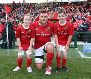 Munster captain on the night CJ Stander with mascots Nikhita Kelly and Eoghan O'Brien.