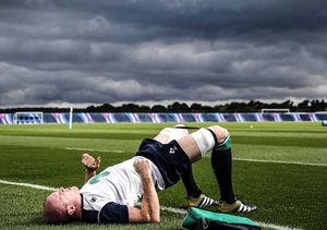 Ireland squad captain and former Munster second row Paul O'Connell warms up before training.