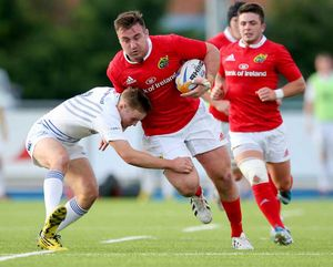 Niall Scannell goes into contact with Ryan Foley in support. Scannell captained Munster 'A' on the night.