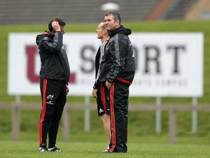 The coaching trio of Brian Walsh, Ian Costello and Anthony Foley chat before training.