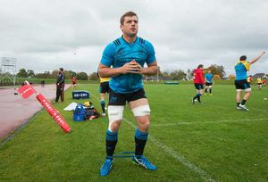 CJ Stander warms up on the resistance bands.
