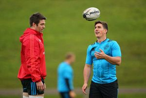 Billy Holland and Ian Keatley chat before training drills get underway.