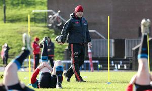 Head Coach Anthony Foley looks on as the players warm up.