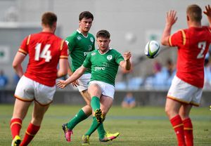 Bill Johnston (Garryowen) kicks a drop-goal in Ireland's opening round win over Grand Slam champions Wales.