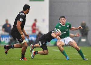 Hugo Keenan is tackled as Ireland take on New Zealand in the World Rugby U20 Championship.