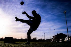 Scrum half Te Aihe Toma practices his kicking before the game in Ennis RFC.