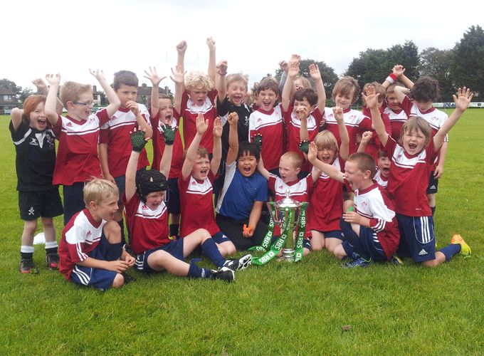 Children attending the Cobh Summer Camp this week pictured with the 6 Nations Trophy.