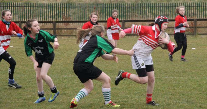 Aisling Brosnan from Colaiste Ide Daingan breaks the tackle