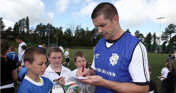 Alan Quinlan signs autographs in Garryowen FC after the Barbarian's training session today
