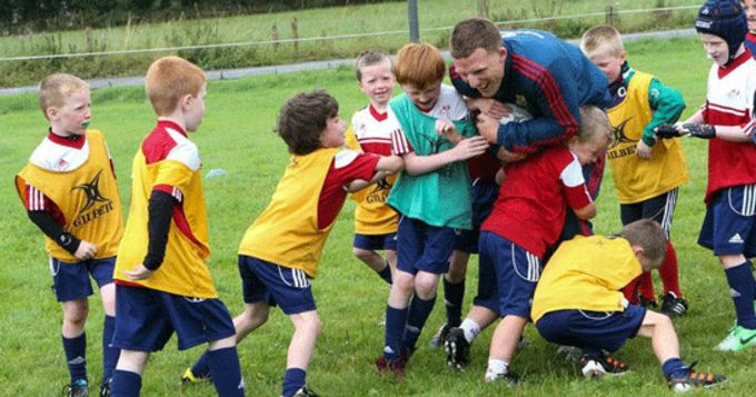 Munster Rugby's new signing Andrew Conway gets stuck in a ruck at Muskerry Summer Camp
