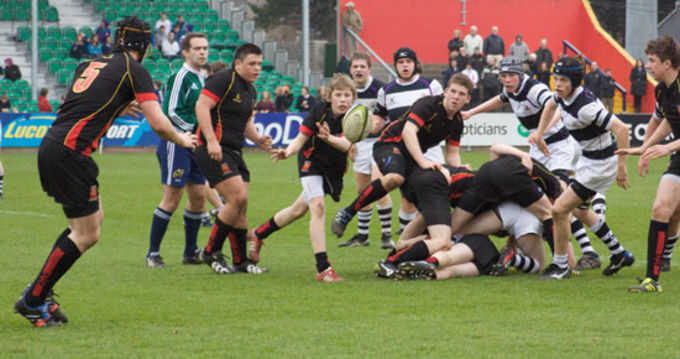 Ard Scoil Ris scrum-half Hugh Bourke passes to Kelvin Brown in their semi final tie with PBC