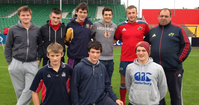 Bantry Bay's Munster U18 rep player Mike Casey pictured with his club coach and team-mates at Musgrave Park