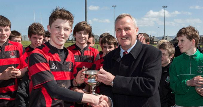 Tony Smith, Chairman of the Munster Schools, presents the Cleary Cup to High School CBS Captain Jack Lonergan