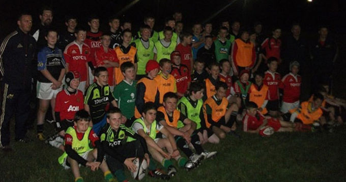 Kilrush U13 and U14 Squads pictured with Munster Rugby's Coach Officers Fiach O'Loughlin and Colm McMahon