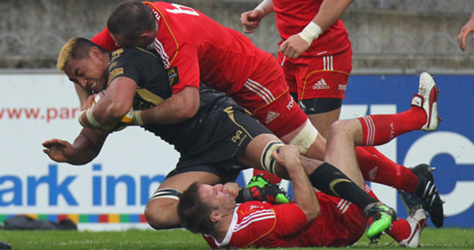 Ospreys Jerry Collins and Munster's Alan Quinlan in Magners League action in Thomond Park last season