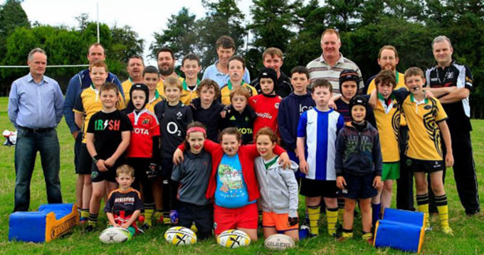 A selection of the Minis and U14s with coaches back for first day training