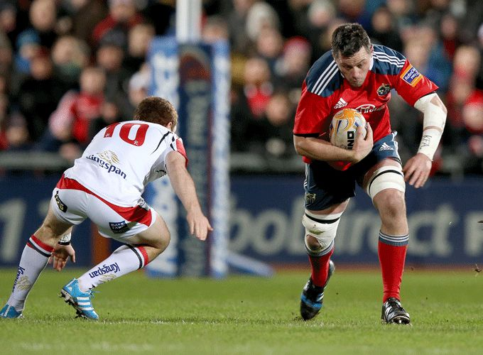 Ulster's Paddy Jackson attempts the tackle on Munster's James Coughlan