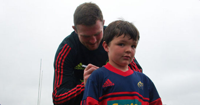 Donnacha Ryan signs an autograph at Balliincollig RFC