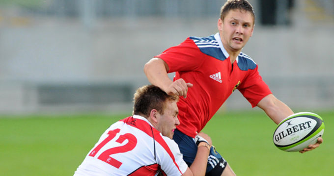 Munster U20's David Johnston tries to get the ball away in the tackle from Mark Best