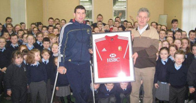 Denis Leamy presents Galbally NS with signed Lions jersey