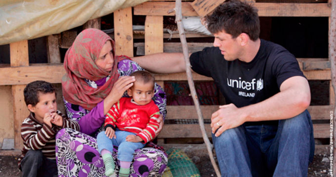 Donncha is pictured with mother Mazna and her children Ahlam, left, and her youngest Hehyam who is suffering from malnutrition in a tented settlement at border area in Akkar.