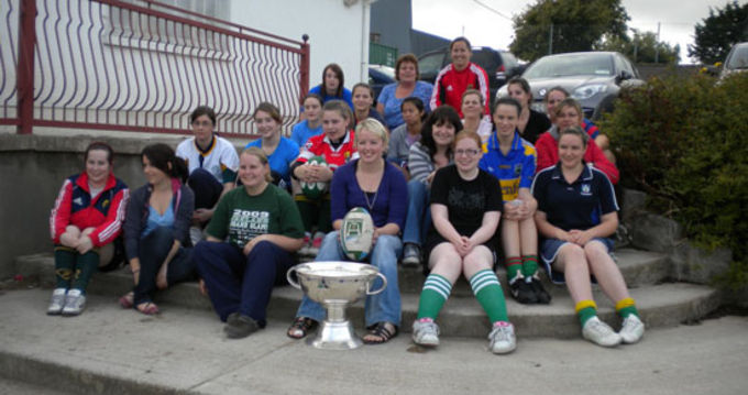 The Fermoy girls get together for a picture with the Magners League Trophy