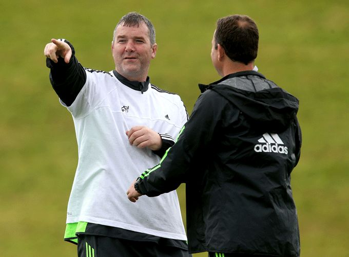 Anthony Foley consults with Assistant Coach Brian Walsh