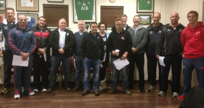 Garryowen mini coaches pictured with Development Rugby Officers Noel O'Meara and Andy Brace