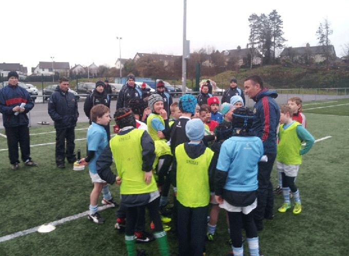 Munster Rugby Community Rugby Officer Fiach O'Loughlin pictured with the Garryowen Under 10's