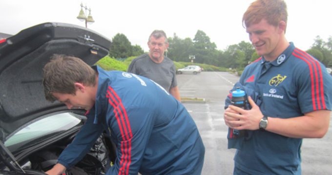 Sean Dougall and Wilie Ryan packing up the car as Team Manager Niall O'Donovan gets ready to take them to their drop-off point