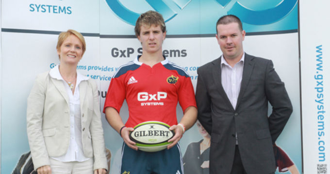 GxP's Managing Director Linda Mellerick and Damien Hanley pictured with Munster U19s outhalf Tomas Quinlan