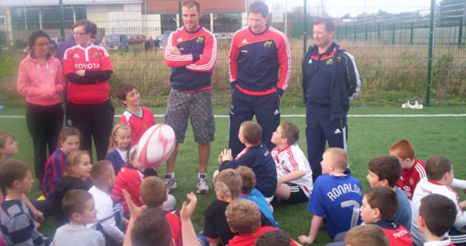 Munster Players Barry Murphy and Ciaran O'Boyle with Munster Community Rugby Officer George Guilfoyle
