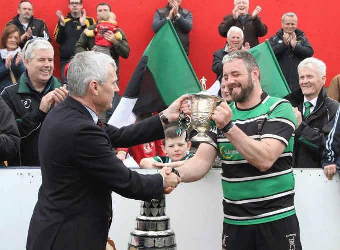 John Hartery, Munster Branch President presents Clonmel Captain Mike Sheehan with the Munster Junior Cup