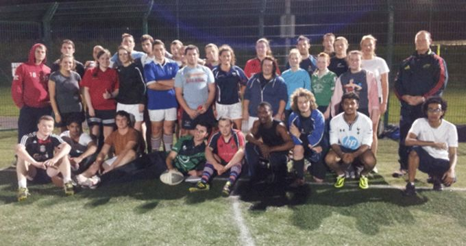 Ed Barnes ITT Rugby Development Officer pictured with some of the College Students at the Tag Rugby Induction Evening