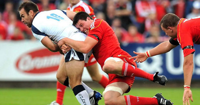 Ian Nagle in action against Sale Sharks putting the tackle in on Charlie Hodgson