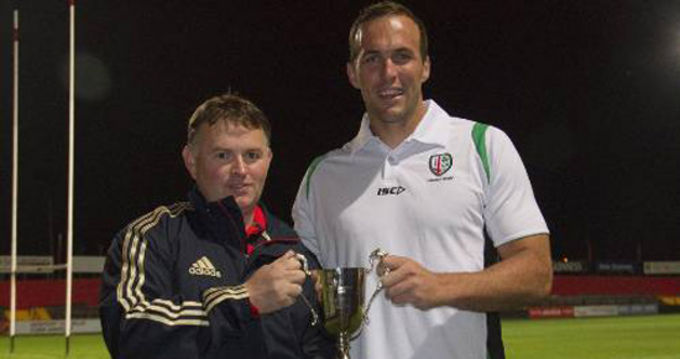 MRSC committee member John O'Dell presents the trophy to London Irish's Bryn Evans last year