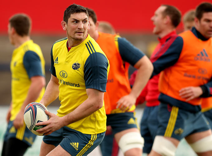 Centre James Downey looks for the offload during Tuesday's session with Billy Holland in the background