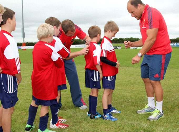 Johne Murphy and BJ Botha sign autographs at last year's summer camp in Nenagh Ormond RFC