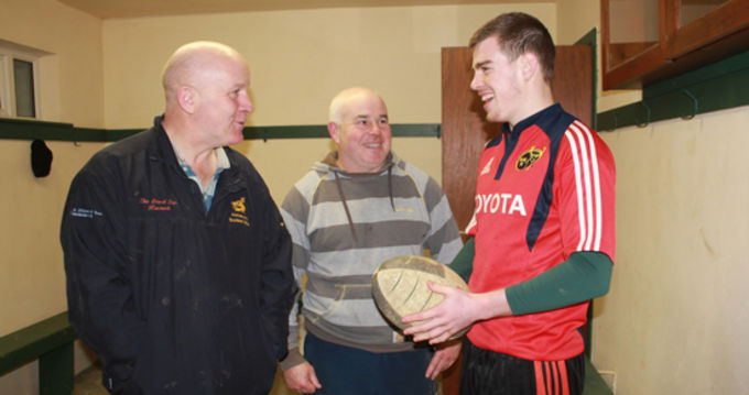 Kanturk Captain Sean Cremin pictured with coaches Noel Sheehan and Brian McAuliffe