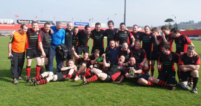 The Killarney team and coaches celebrate their Munster Junior Plate Final victory over Newport at Musgrave Park on Sunday