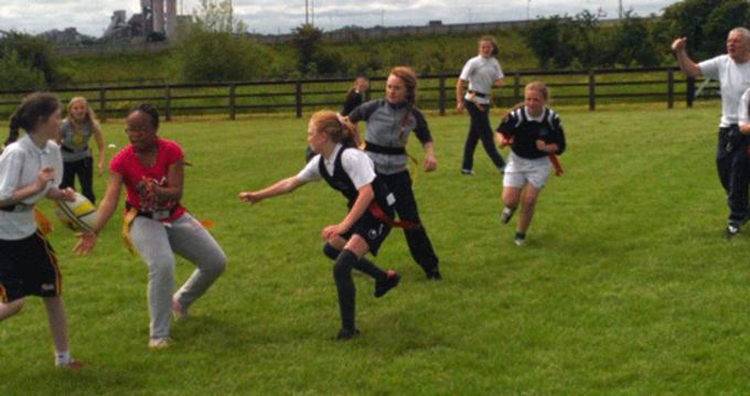 National school pupils participating in the girls rugby festival at Shannon RFC